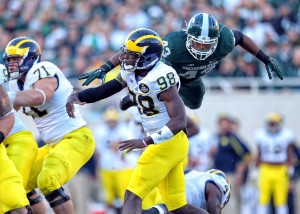 Oct 25, 2014; East Lansing, MI, USA; Michigan State Spartans linebacker Ed Davis (43) flies over block of Michigan Wolverines running back De'Veon Smith (4) during the 2nd half of a game at Spartan Stadium. MSU won 35-11. Mandatory Credit: Mike Carter-USA TODAY Sports ORG XMIT: USATSI-182278 ORIG FILE ID: 20141025_lbm_mb2_290.JPG