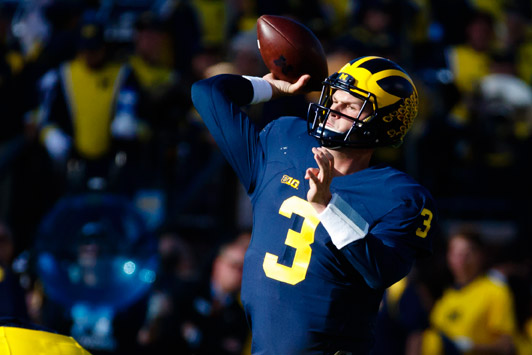Michigan Quarterback Wilton Speight Throws the ball. Sports Q&A